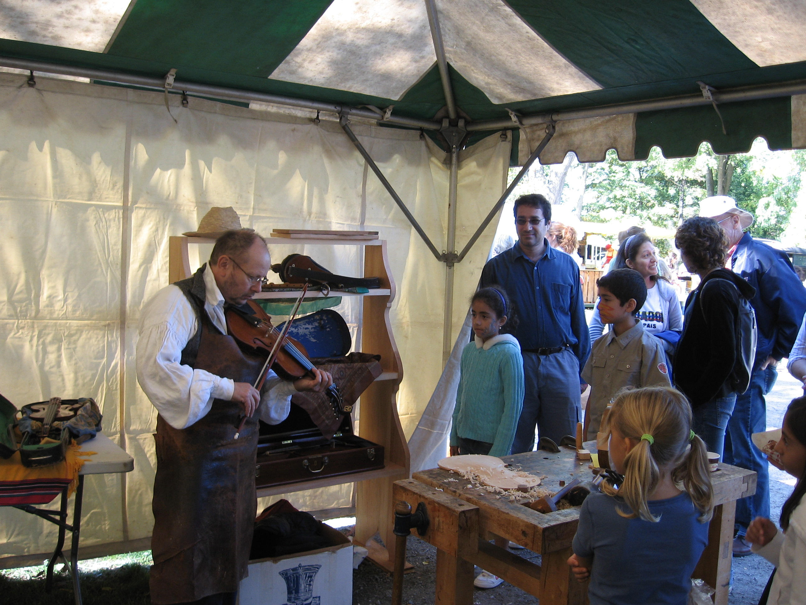 Phil plays fiddle for visitors to Pioneer Day, Jordan Museum, 2007