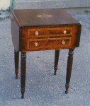 Mahogany late Sheraton style drop-leaf table made of mahogany and inlaid with satinwood and rosewood