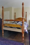 Tall post bed, made of cherry and bird's eye maple.