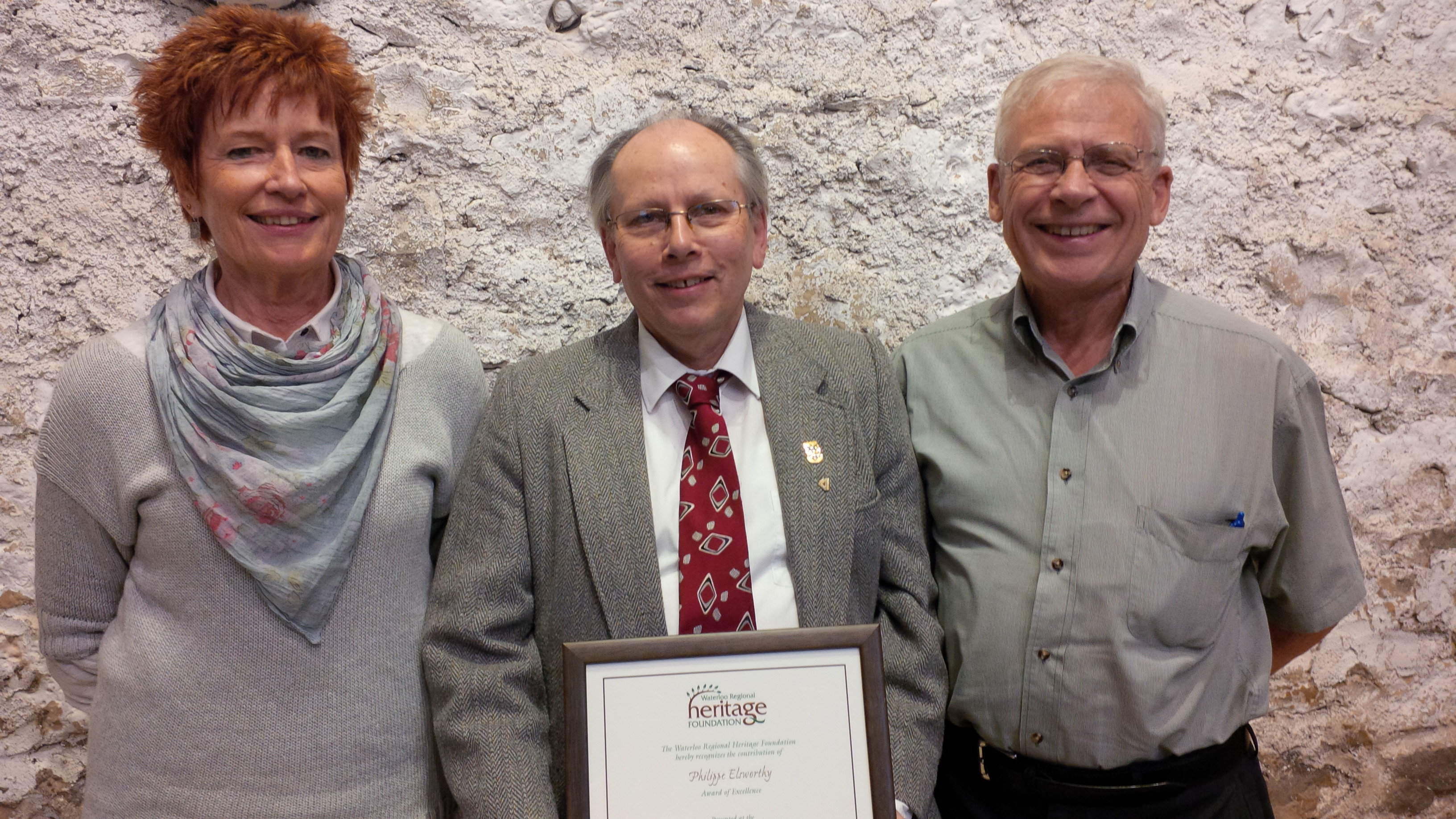 Phil with his Waterloo Regional Heritage Foundation Award, standing between his award nominators, Susan Burke and John Arndt.